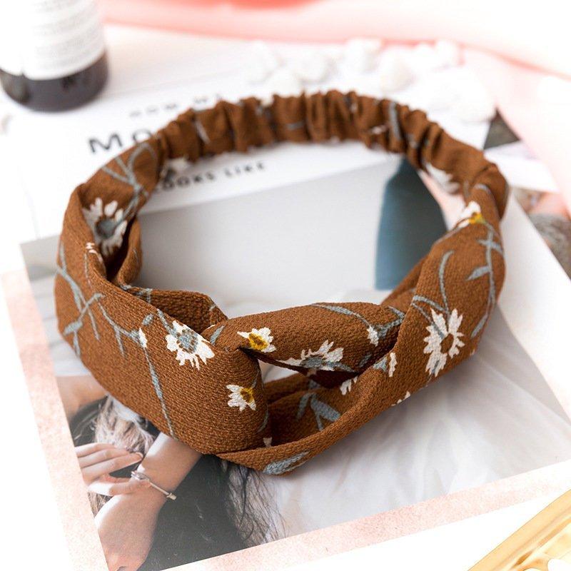 Hårband med blomstermönster i färgen brun