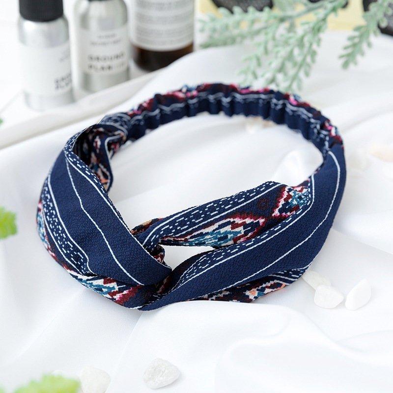 Bohemiskt elastiskt hårband i blått och vita linjer