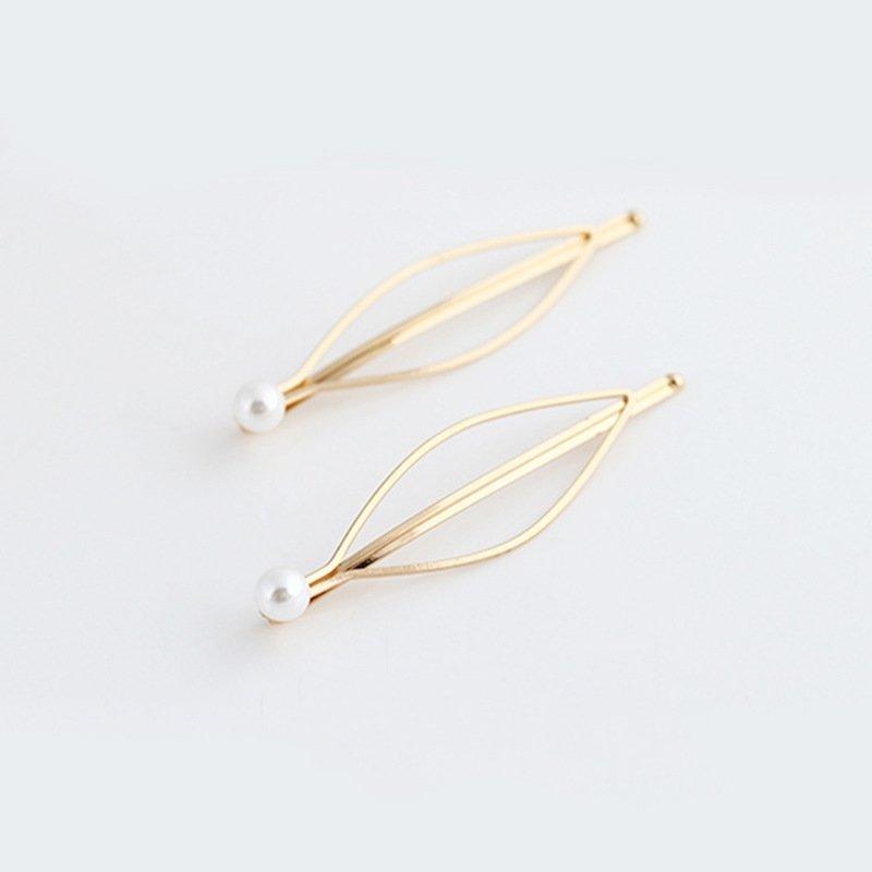 2 stk hårnålar i guld med pärla