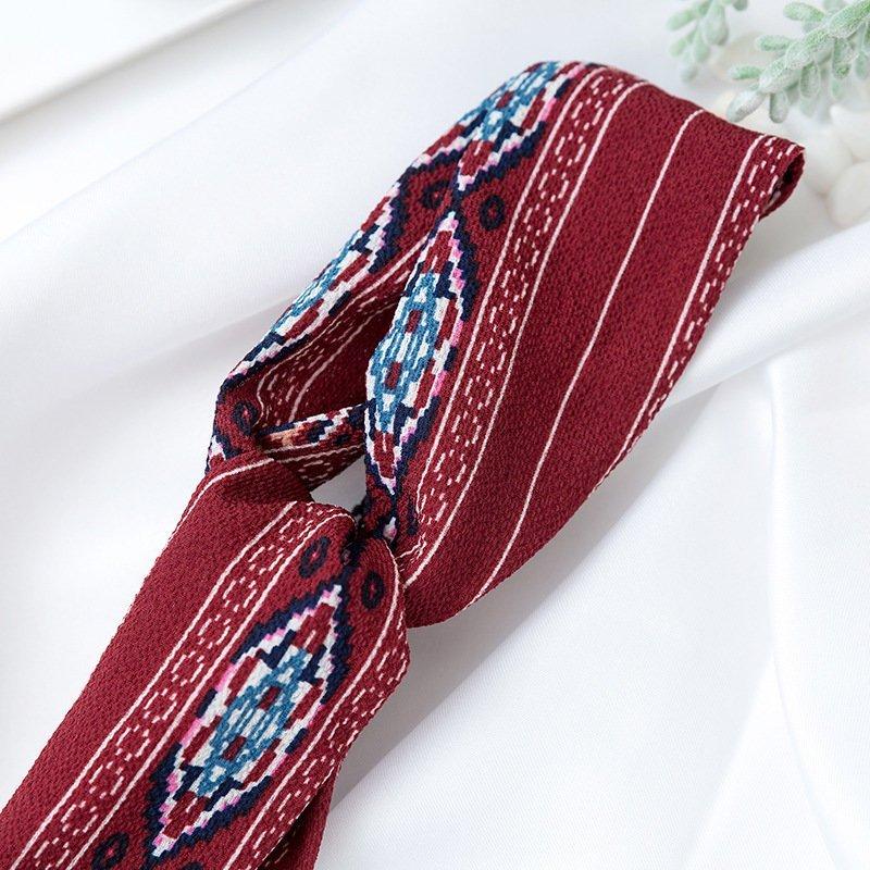 Bohemiskt elastiskt hårband i rött med vita linjer