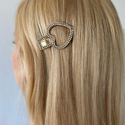 Trendig hårklämma i form hjärta klädd med strass som glimmar