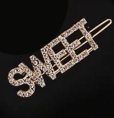 Hårnål med ordet ''Sweet'' i strass färgen guld