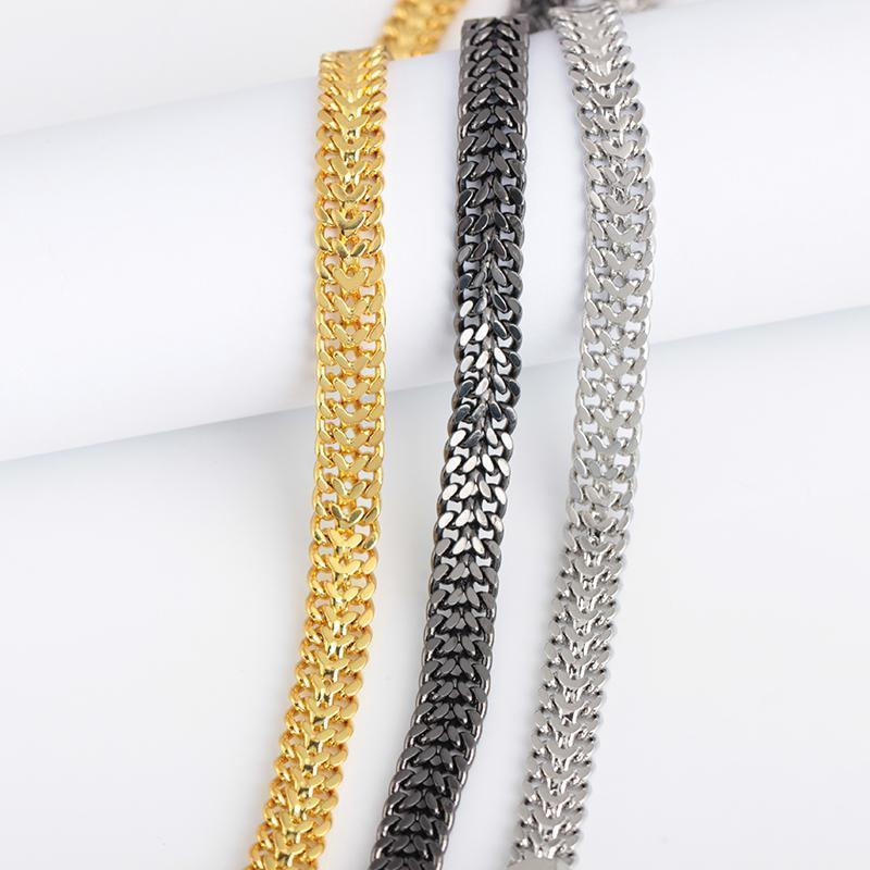 Unikt lyxigt armband i silver, guld & svart punk
