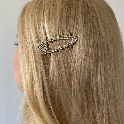 Trendig hårklämma klädd med strass som glimmar