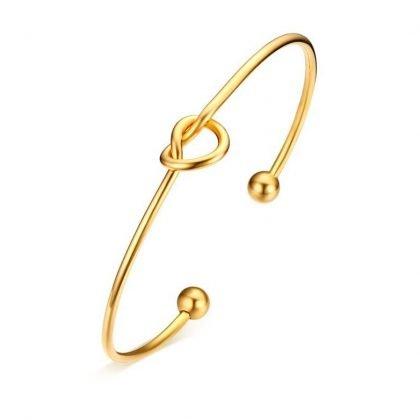 Guldpläterat armband med knut
