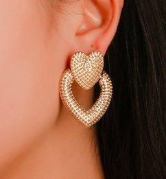 Örhänge i guld med dubbla hjärtan