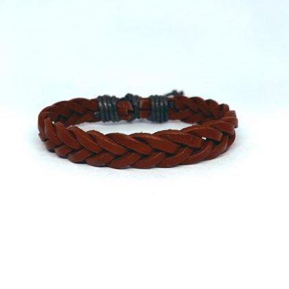 Handgjort flätat armband i orange läder