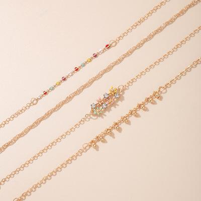 Set á 4 stk orientaliska rhodiumpläterade armband med stenar smycken