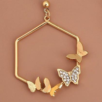 Geometriska örhängen i guld med fjärilar och strass hexagon